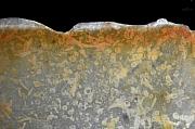 IJzerinfiltratie in een Neanderthalerwerktuig uit Zeijen (Drenthe)